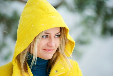young blond woman in the winter forest