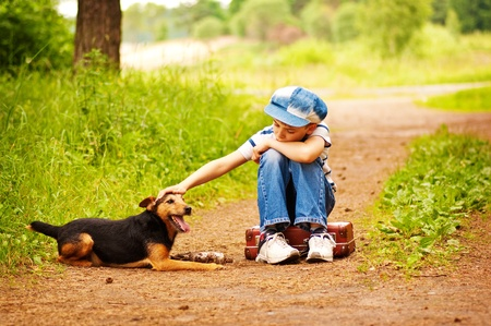 The boy with his dog in the forest  photo