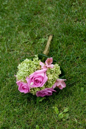 wedding bouquet with pink roses and viburnum blossoms