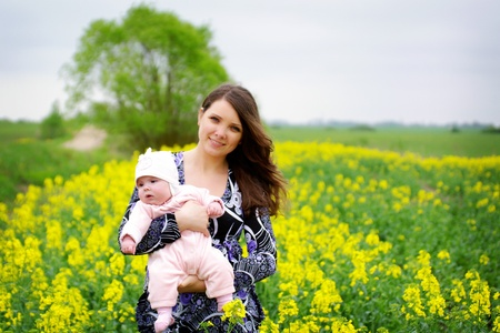 Mother with her baby outdoors