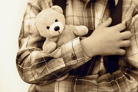 Safety concept. The boy is holding teddy bear
