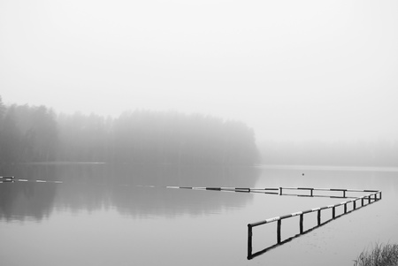 Lake on foggy winter day photo
