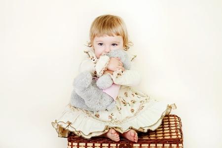 little girl hugging toy bear