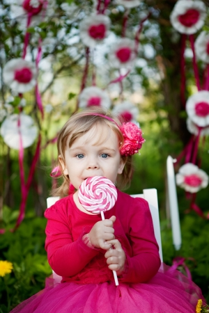 little girl with big lollipop Stock Photo