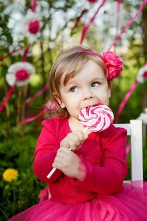 little girl with big lollipop 写真素材