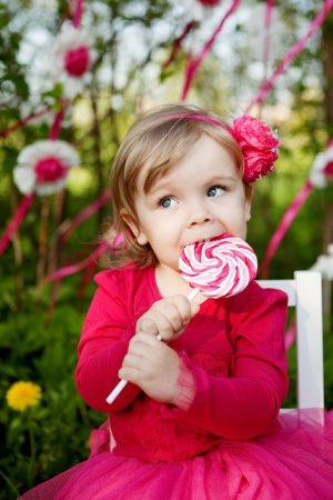 little girl with big lollipop photo
