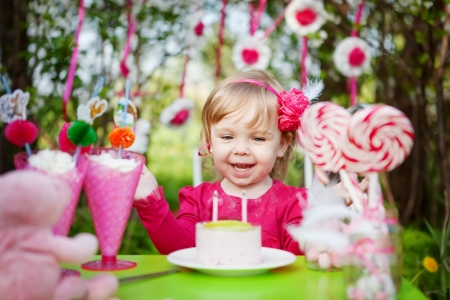 birthday celebration: happy girl with birthday cake outdoors Stock Photo