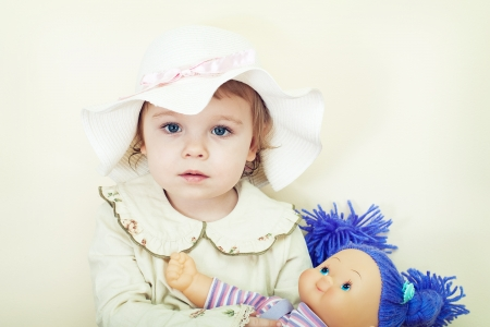 little girl with doll photo