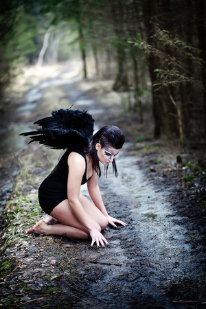 Fantasy image with a fallen angel photo