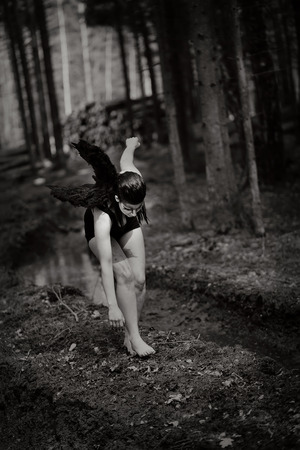 falling feather: Fantasy image with a fallen angel