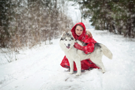 girl in red dress: Girl with dog outdoors