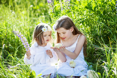 two cute  sisters outdoors