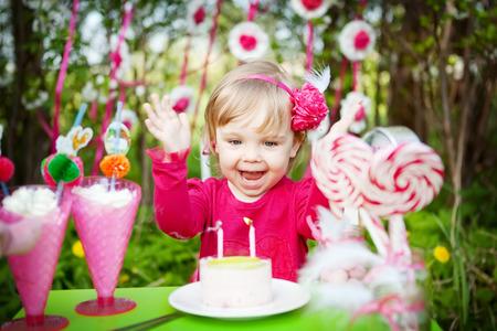 happy girl with birthday cake outdoors Stock Photo
