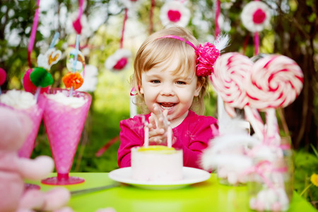 happy girl with birthday cake outdoors Stock Photo