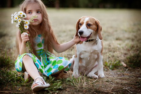 little girl with the dog outdoors