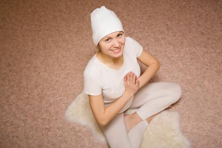 kundalini: Meditation, young woman in yoga lotus pose Stock Photo