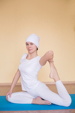 kundalini: pretty young woman is engaged in kundalini yoga