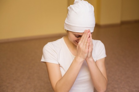 plead: beautiful young woman in white praying Stock Photo