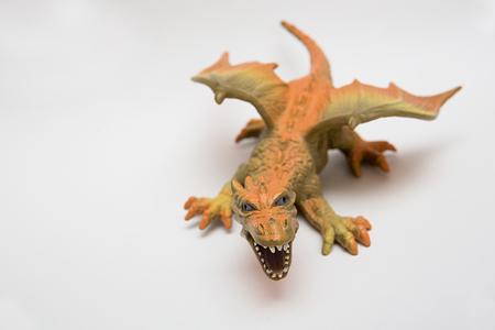 illustrative editorial: orange toy dragon