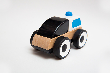 wooden toy car on the white background