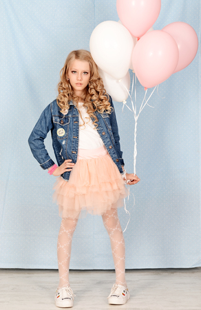 girl dressed Barbie with balloons