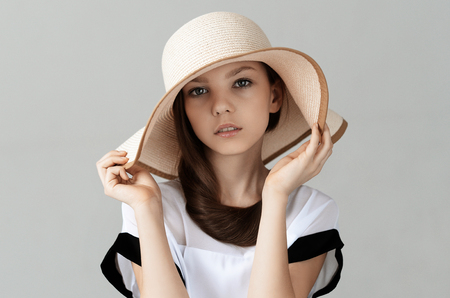 provocative woman: elegant girl with beautiful hat posing in Studio Stock Photo