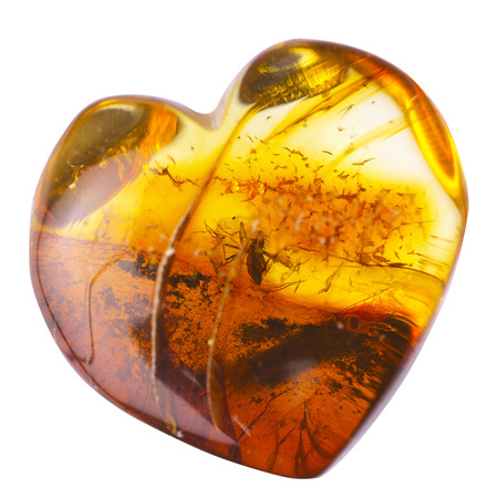 Amber stone inclusion in heart shape.
