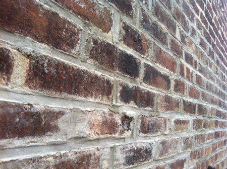 Close-up of red brick wall in perspective  Reklamní fotografie