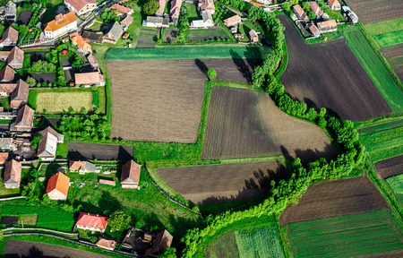 Birds Eye View of the Village and Countryside with Fields of Crops.