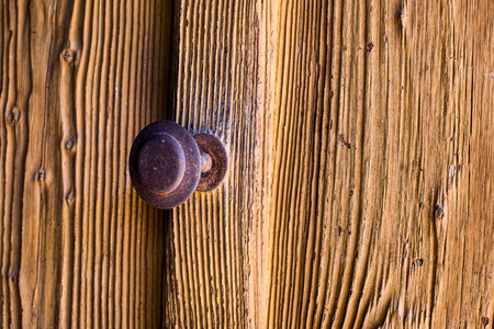 view of a wooden doorway: Rusted Old Door with Handle.