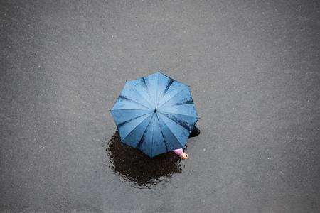 birds eye view: People with Umbrella in the Rain, Birds Eye View.