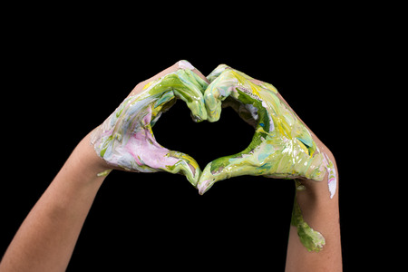 Painted hands make a heart shape. Love Shape Hand.