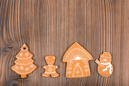 shortbread: Home-baked and decorated gingerbread on wooden background.