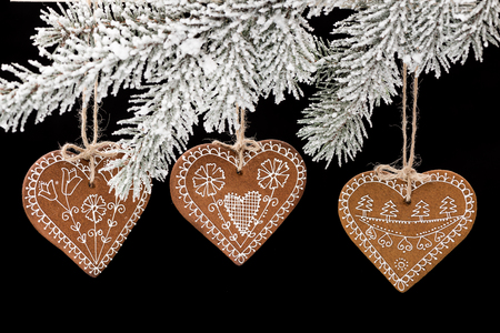 Home-baked and decorated gingerbread on black background. Stock Photo