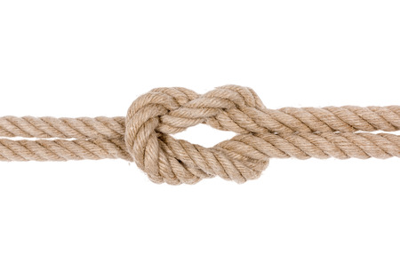 overhand: Nautical rope knot. Square knot isolated on white background. Stock Photo
