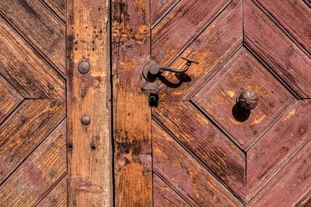 door handle: Old wooden door with iron handle on the church. Old Door Handle. Stock Photo