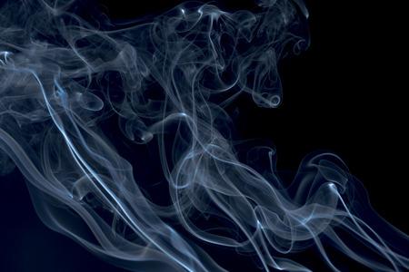 Incense on a black background. Smoke on a black background. Smoke movement patterns of background graphics. Stock fotó