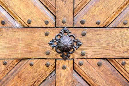 Old wooden door with iron handle on the church. Old Door Handle. Stock fotó