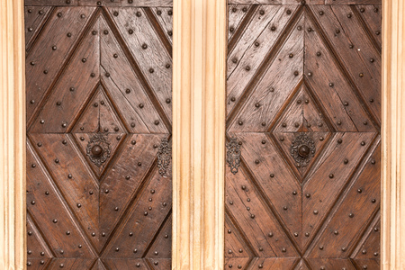 Old wooden door with gothic architecture detail. Door Detail for Backgrounds.