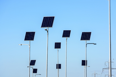 Street lighting works from solar panels on blue sky background. Stock fotó - 112601662