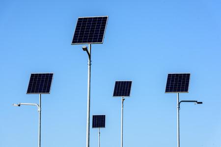 Street lighting works from solar panels on blue sky background. Stock fotó - 112601663