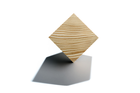 Abstract geometric real wooden cube isolated on white background with real shadow and its not 3D render.