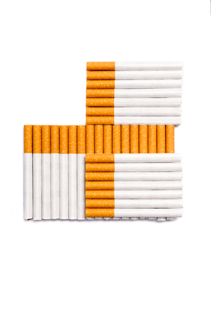 Cigarettes in cross shape form. Conceptual image of a no smoking idea isolated on white background. Stock fotó - 117960558