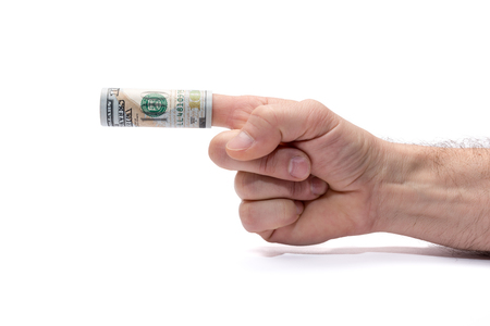 Conceptual image of dont or accepting bribes. Hand pointing left, a hundred dollar banknote wrapped around his finger.