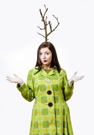 Funny mime playing on a white background, a branch grows from his head.