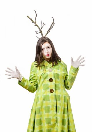 Funny mime playing and gesturing isolated on white background with a branch grows from his head.