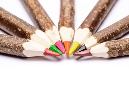 Handmade wooden color pencils on white background. Crayon isolated on a white background.