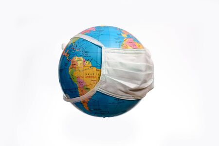 Conceptual image of earth globe with a face mask, isolated on a white background. Human Epidemic Danger. Stock Photo