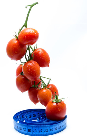 Fresh tomatoes on vine Banco de Imagens