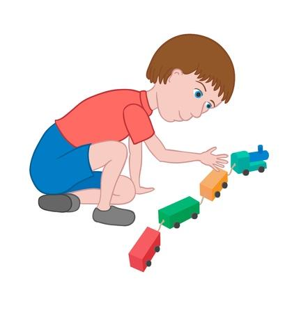 en cuclillas: Niño jugando con el tren de juguete